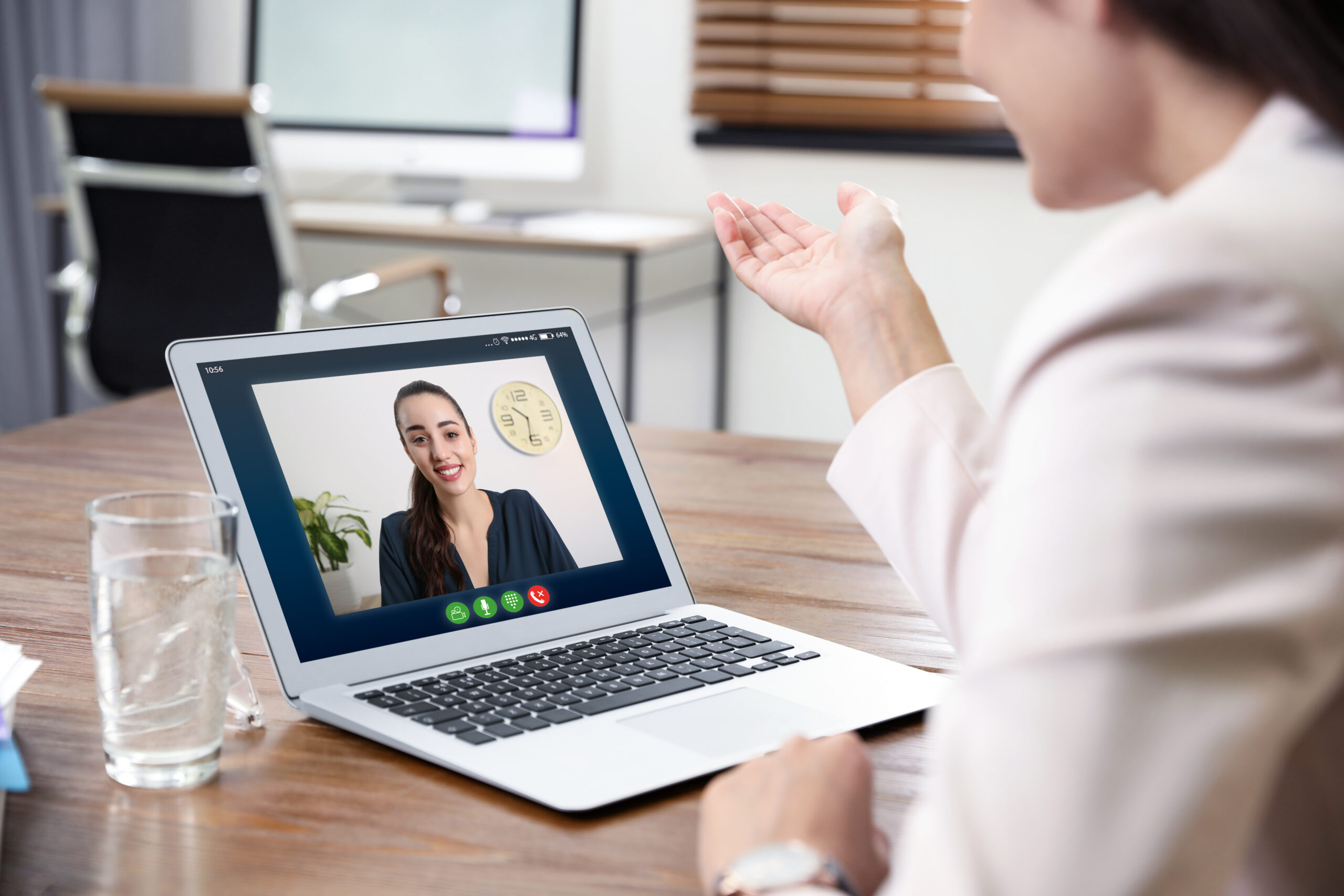 Woman using video chat on laptop in home office, closeup. Space
